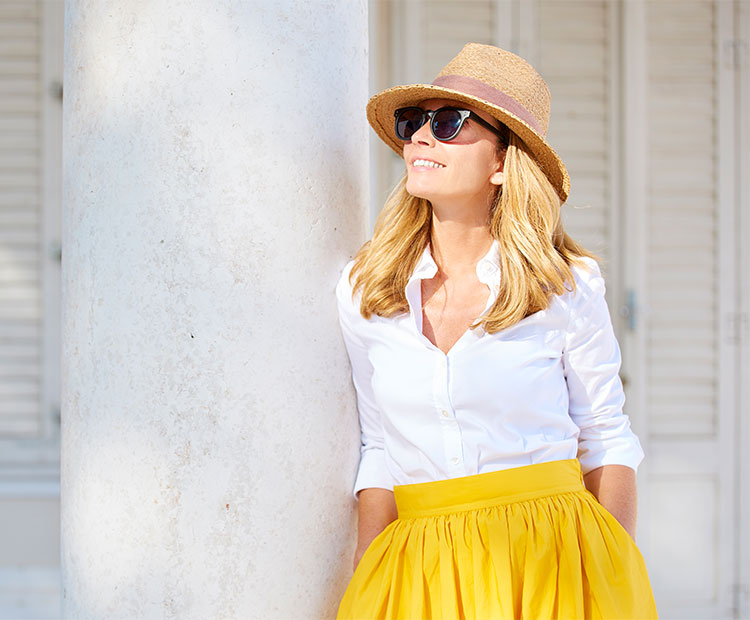 Girl with a hat and sun glasses in a yellow skirt 1