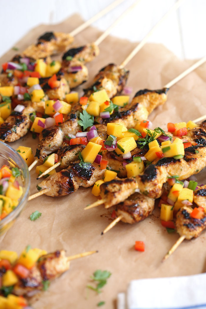 These Mango Sriracha Chicken Skewers are the perfect balance of sweet and spicy topped with a mango salsa that is sure to be a hit at your next cookout!