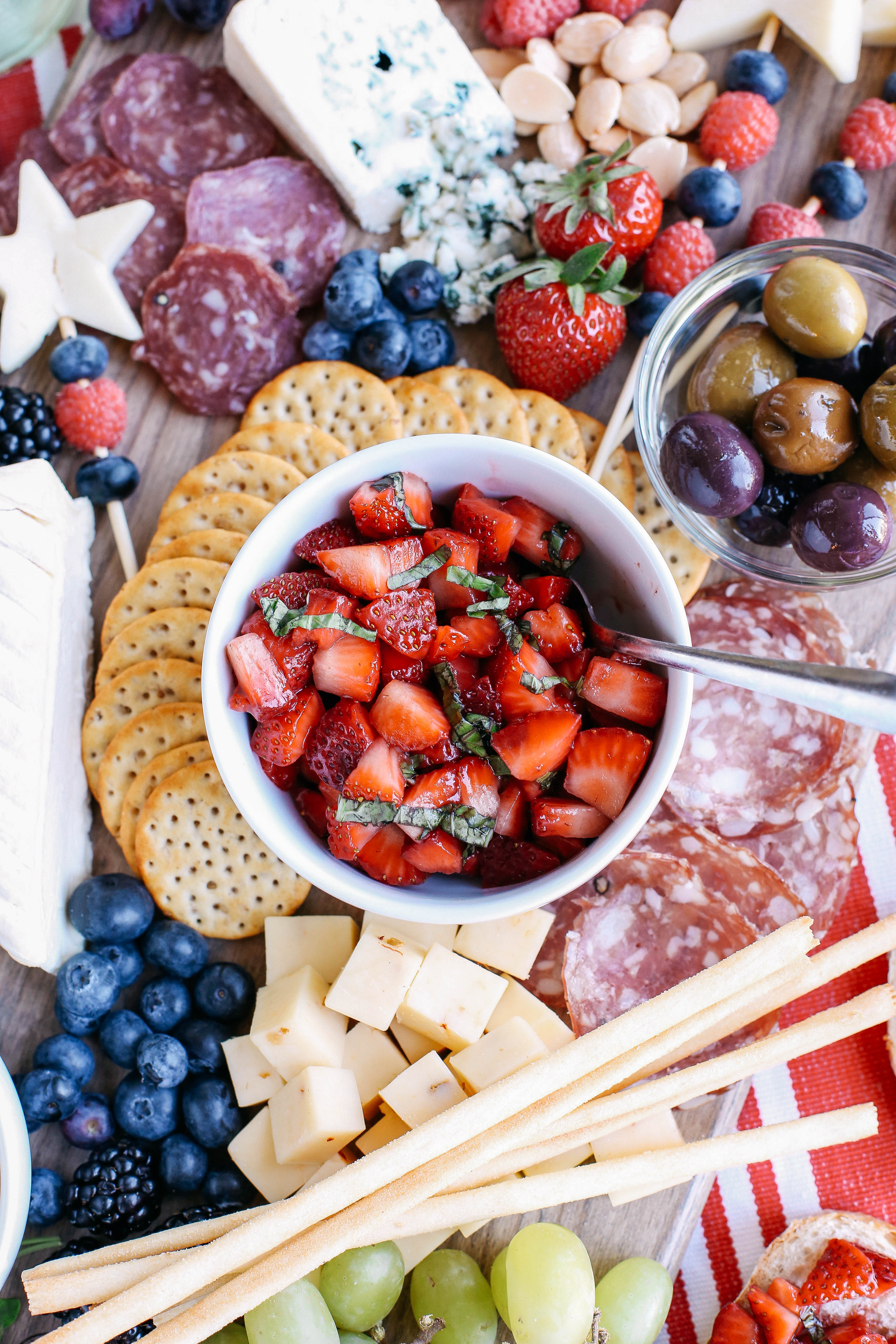 Memorial Day is right around the corner so kick off the summer with the Ultimate Patriotic Cheeseboard! Grab your favorite bottle of wine and share this festive appetizer with your friends and family this holiday!