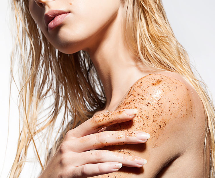 Blonde girl applying body scrub 1